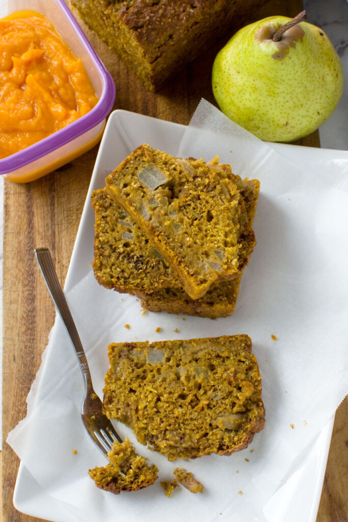 Slices of healthy pumpkin and pear bread on a plate from above