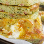 A close up of a stack of zucchini slice on a baking tray