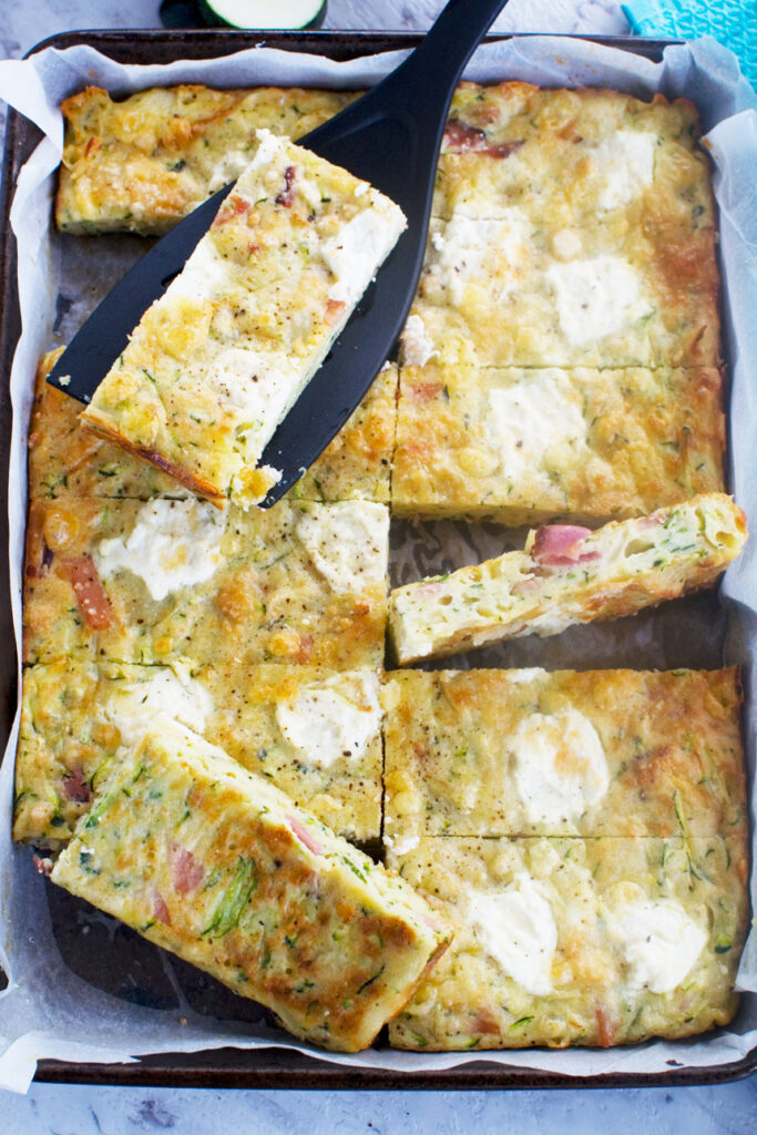 A baking tray of zucchini slice from above