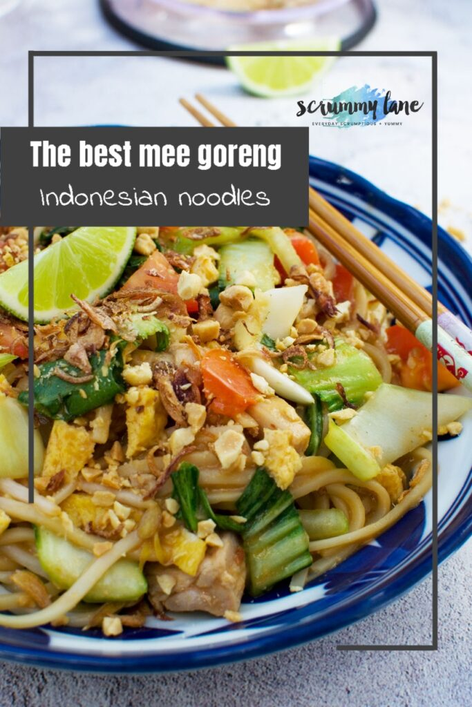 A close-up of a bowl of mee goreng basah or wet Indonesian noodles with title on for Pinterest