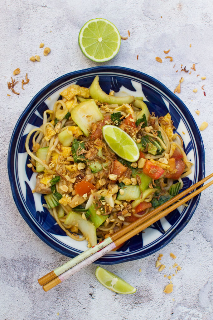 A bowl of mee goreng basah or 'wet' Indonesian noodles taken from above with chopsticks