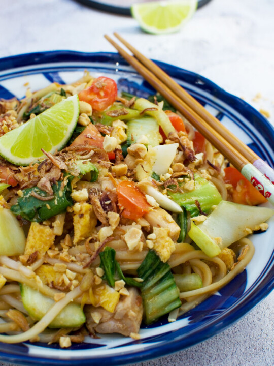 A dish of mee goreng basah or spicy Indonesian noodles with chopsticks