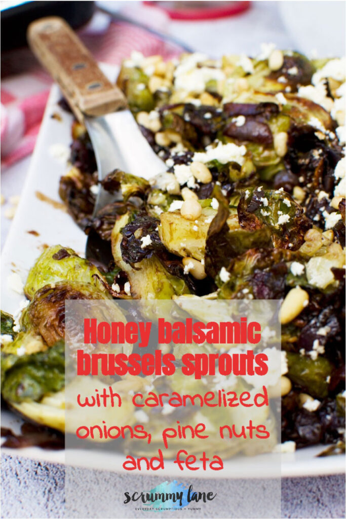 A Pinterst image of honey balsamic brussels sprouts with pine nuts and feta with a title