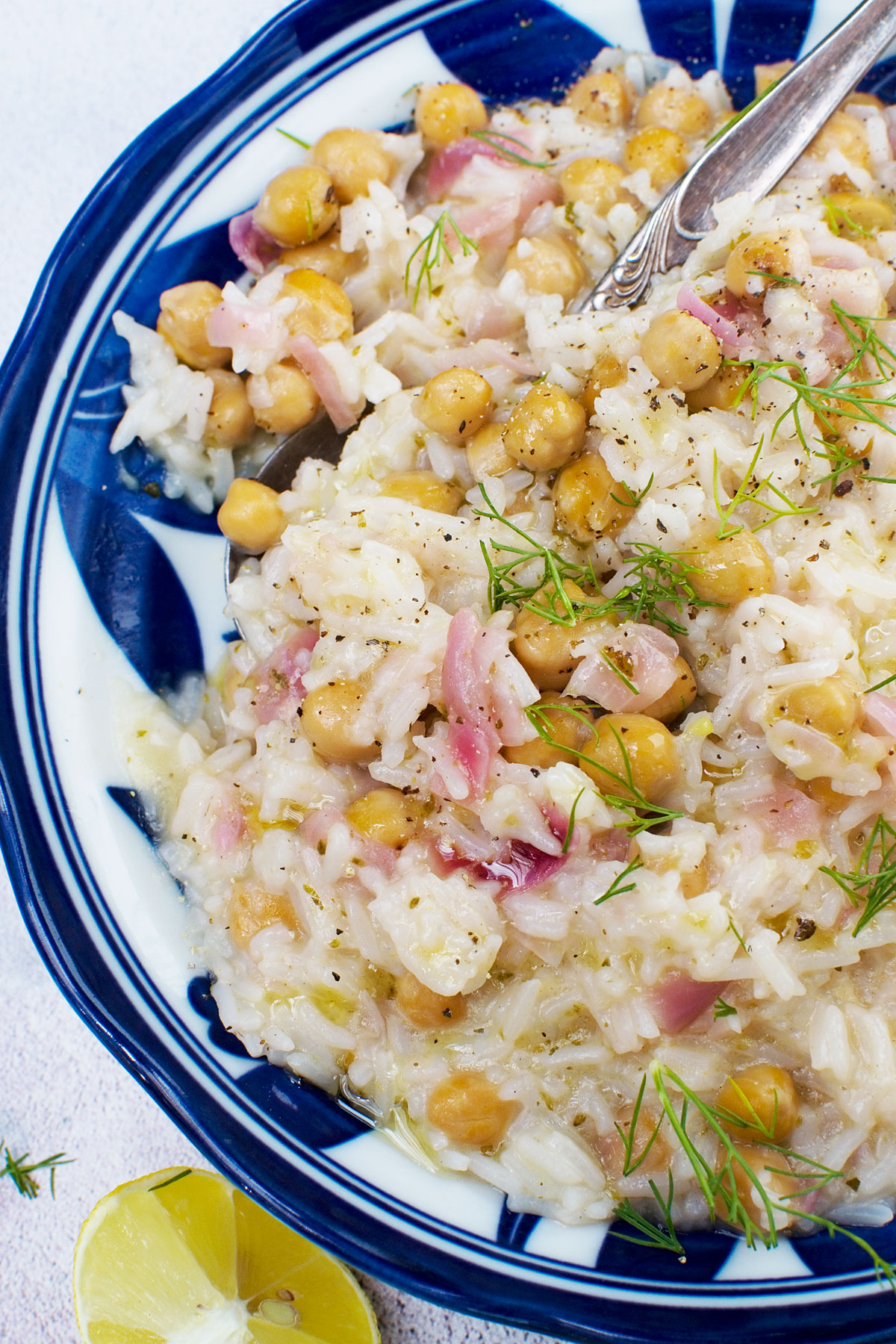 A closeup of a plate of 10-minute lemony Mediterranean rice with chickpeas