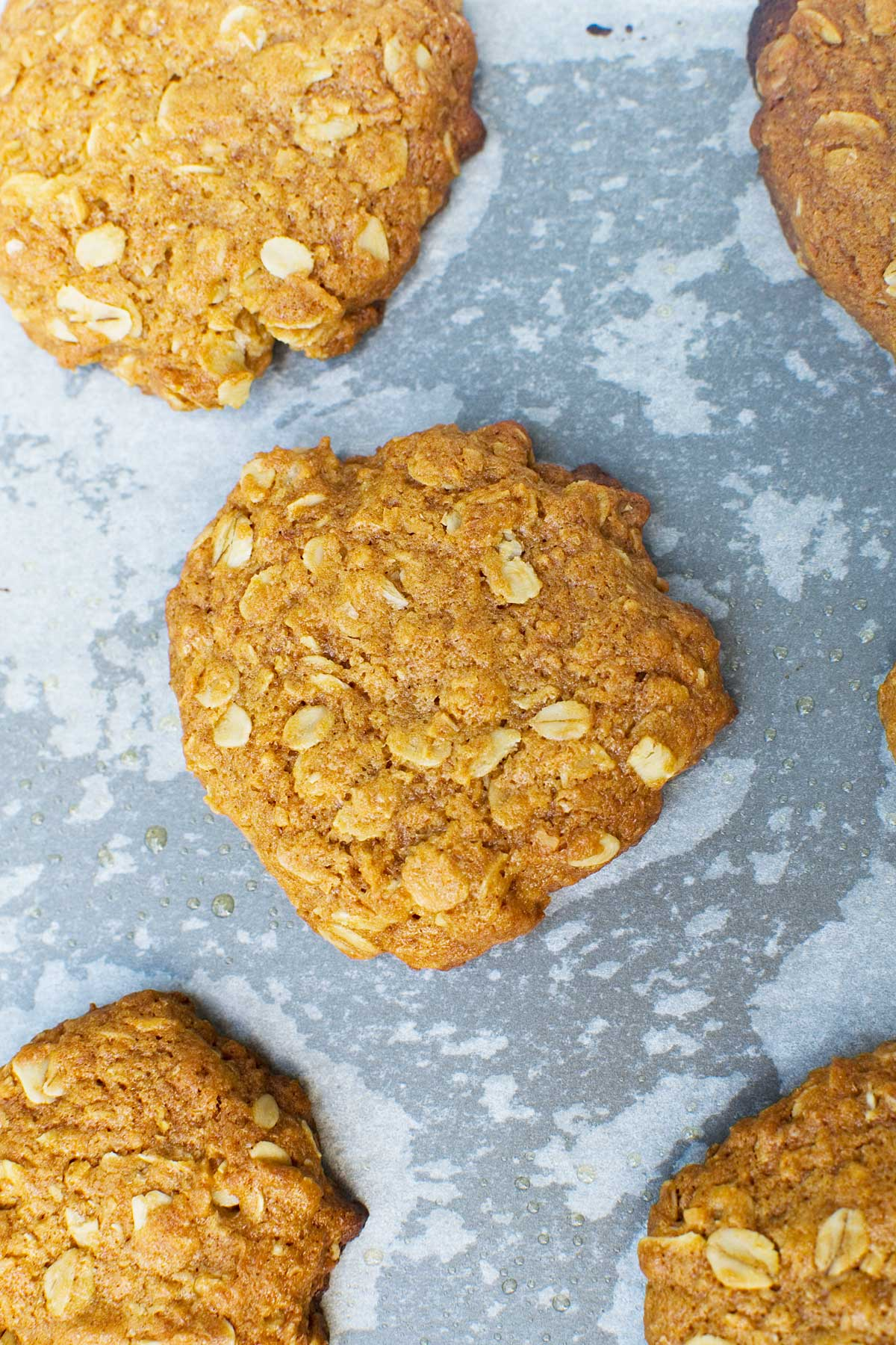 Anzac biscuits up close on a baking tray from above