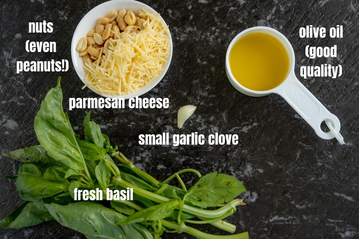 Picture of the ingredients needed to make pesto: nuts, olive oil, parmesan cheese, garlic, fresh basil