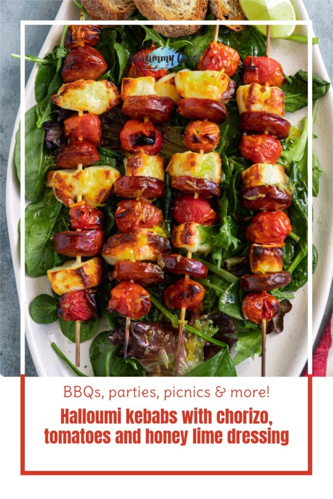 4 halloumi kebabs on a big white platter from above and with a title on it for Pinterest