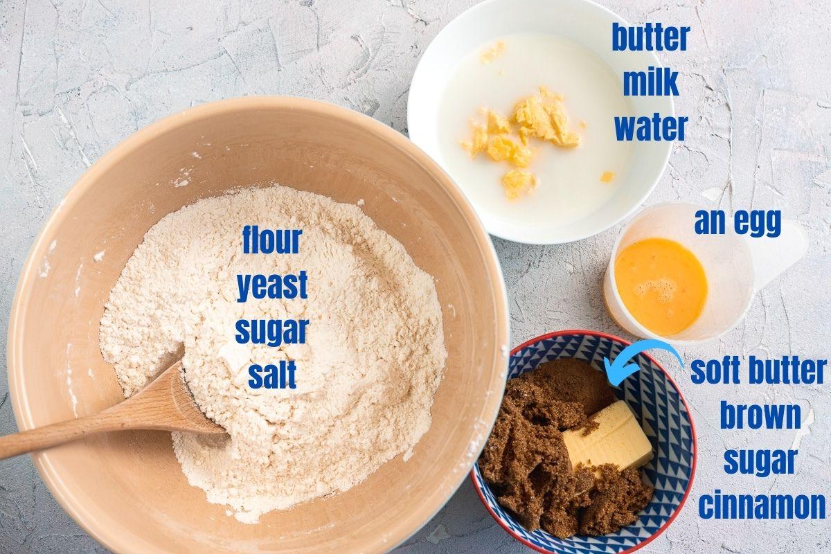 Images of the ingredients needed to make cinnamon scrolls: flour, yeast, sugar, salt, butter, milk, water, an egg, butter, brown sugar, cinnamon